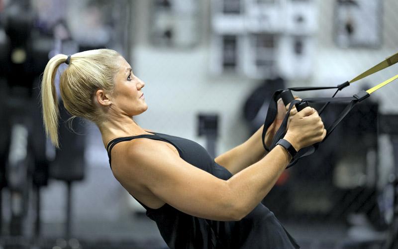 Woman doing TRX exercises