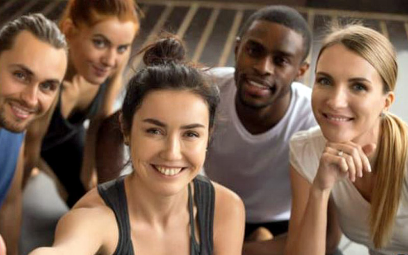 smiling group of people at the gym