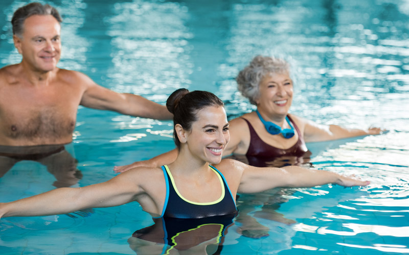 Group of people exercising in a pool